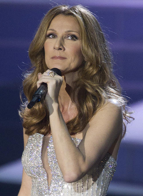 FILE - In this March 15, 2011 file photo, Celine Dion sings the opening number during her opening night performance at Caesar's Palace in Las Vegas. Dion says she is recovering from a virus that caused an inflammation of her vocal cords and says she's planning to return to the stage in Las Vegas soon. Dion said in a statement Monday that she received good news last week during a follow-up examination with her doctor in Los Angeles. Dion announced last month that she was cancelling her shows at Las Vegas' Caesars Palace until June 9 because of her illness. (AP Photo/Julie Jacobson, file)