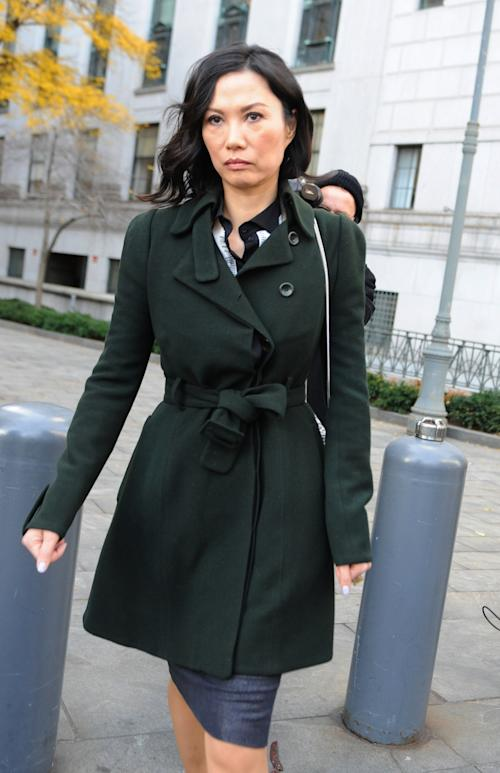 "Wendi Deng Murdoch exits State Supreme court, Wednesday, Nov. 20, 2013, in New York. Deng Murdoch, and her husband, Rupert Murdoch, said they were parting with ""mutual respect"" Wednesday after telling a judge they had reached a divorce settlement. (AP Photo/ Louis Lanzano)"