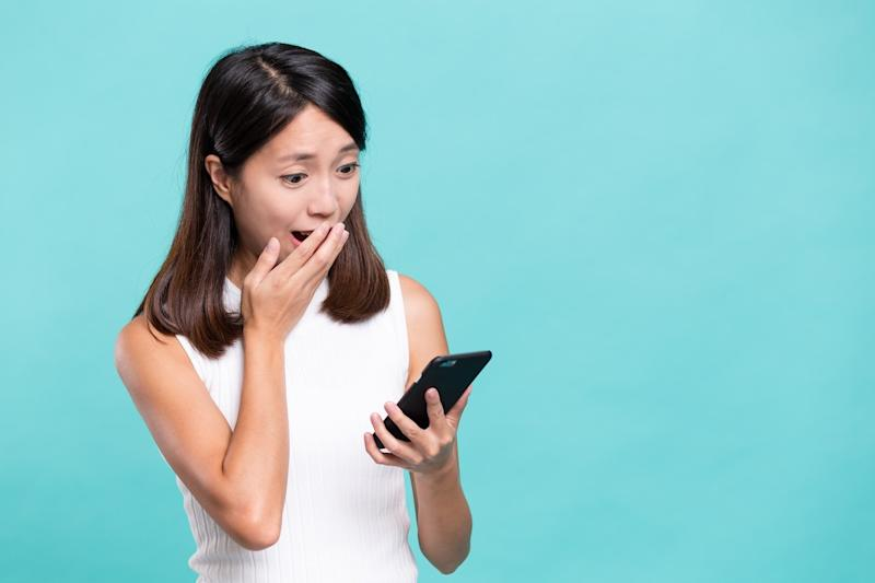 shocked woman looking at a phone against a light blue background, did you know facts