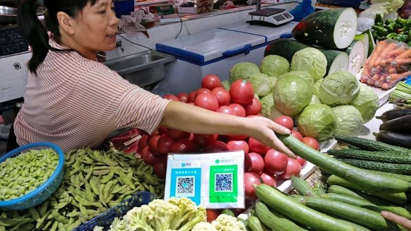 A food stall in china with QR codes for users of WeChat to pay by scanning it with their devices