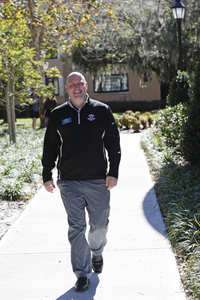 In this Tuesday, Jan. 28, 2020 photo, Leon Hayner, an associate dean of students at Rollins College walks on the campus in Winter Park, Fla. Because of the federal privacy law, university administrators, if called upon, won't be able to disclose students' sex, race or Hispanic origin on the 2020 Census form. (AP Photo/John Raoux)