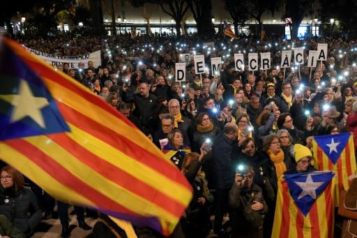 People take part in a demonstration in Barcelona against the trial of former Catalan separatist leaders