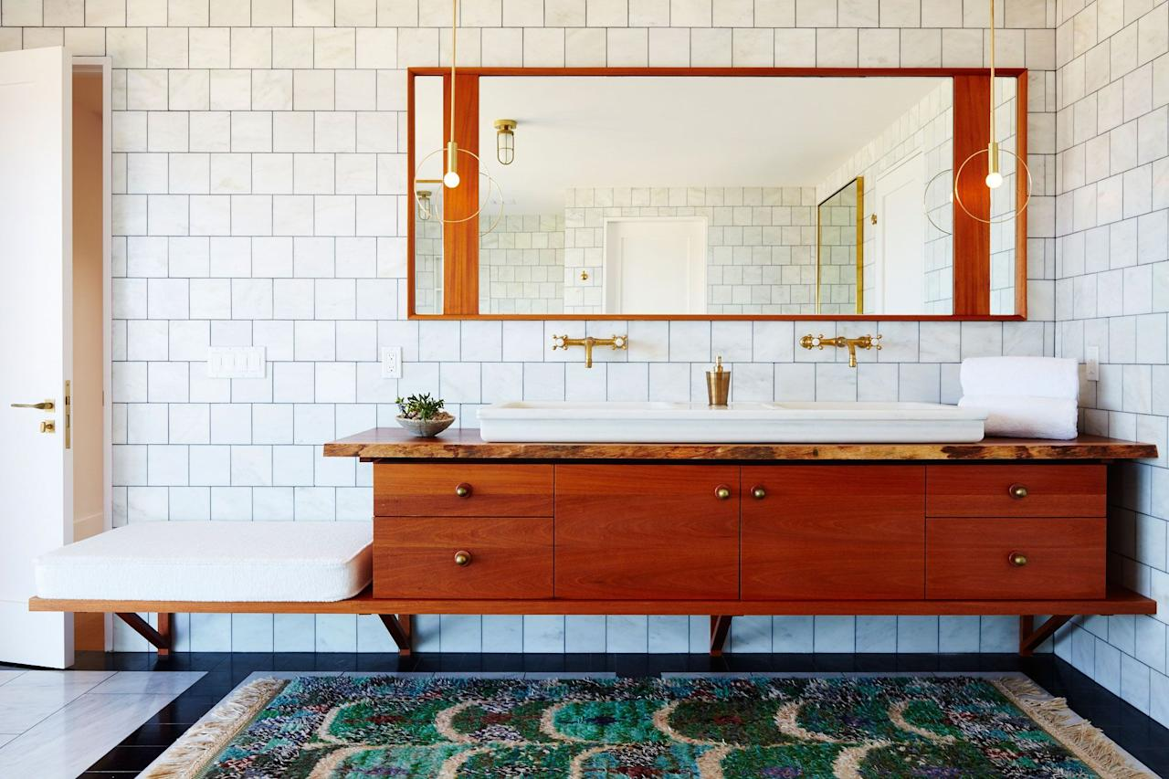 "<p>Above all else, a <a href=""https://www.housebeautiful.com/room-decorating/bathrooms/g27008949/bathroom-wallpaper/"" target=""_blank"">bathroom</a> needs to be clean and tidy. But it doesn't need to be <em>purely </em>functional, especially if you appreciate a nice atmosphere for bubble baths or mirror selfies. Add a cozy chair, or some proper window treatments. You'll be amazed at how much it warms up the space. To spark some creativity in your own home, we've collected a slew of bathroom ideas to help you create an oasis for spa-level relaxation and style at home. Whether you're thinking of sprucing up the <a href=""https://www.housebeautiful.com/room-decorating/bathrooms/how-to/g916/powder-room-decorating-ideas-0710/"" target=""_blank"">powder room</a> and  <a href=""https://www.housebeautiful.com/room-decorating/bathrooms/g942/master-bathroom-ideas/"" target=""_blank"">master bath</a>, or you're embarking on a full-on ensuite renovation, we've got inspo to make your bathroom serious #goals. Take design advice from the likes of <a href=""https://www.housebeautiful.com/design-inspiration/home-makeovers/a30297943/leanne-ford/"" target=""_blank"">Leanne Ford,</a> Commune, and <a href=""https://www.housebeautiful.com/lifestyle/a25647685/toledo-geller-interior-designers/"" target=""_blank"">Toledo Geller</a> to create a space that's inspiring and calming—you just might never leave the tub! </p>"