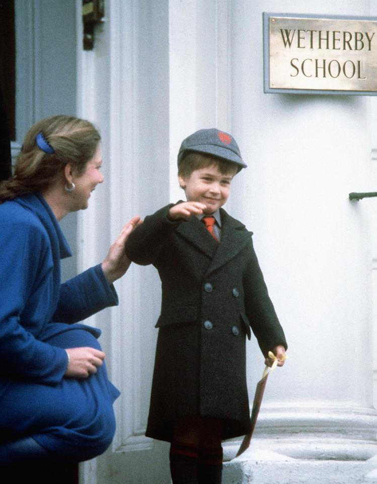 Prince William waves at onlookers after his first day at Wetherby School in Notting Hill Gate, London, in 1987. [Photo: PA]