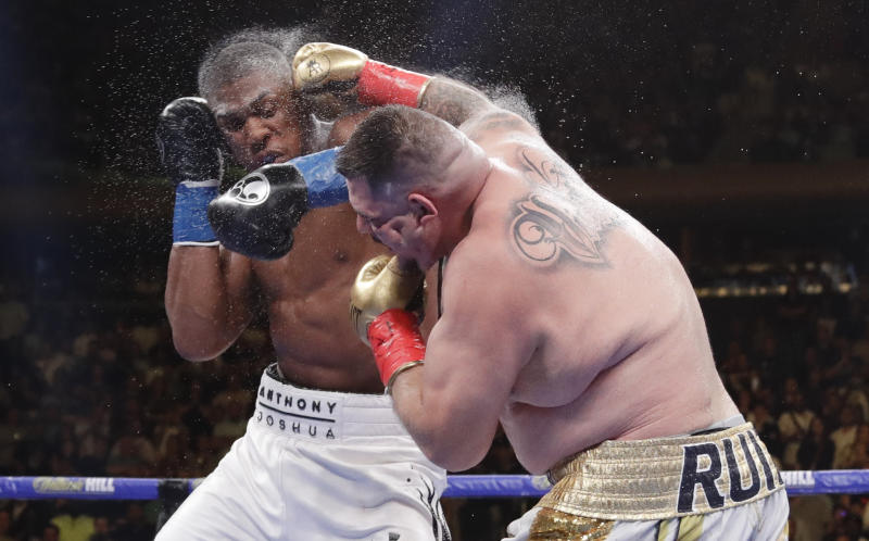 Andy Ruiz, right, and Anthony Joshua exchange punches during the seventh round of a heavyweight championship boxing match Saturday, June 1, 2019, in New York. Ruiz won in the seventh round. (AP Photo/Frank Franklin II)