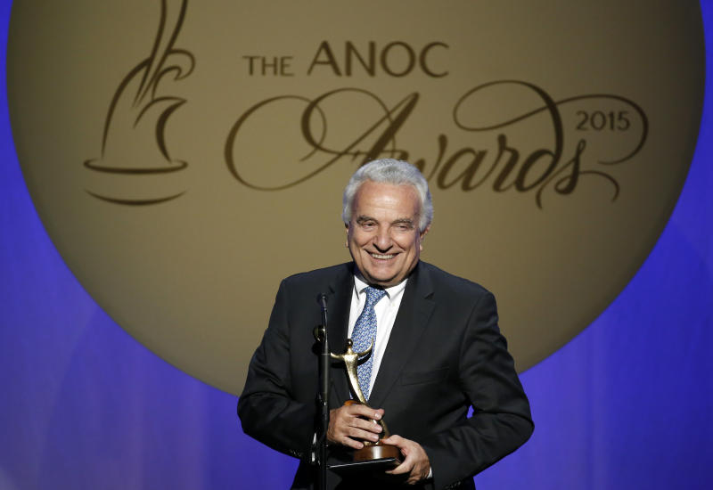 """FILE - In this Thursday, Oct. 29, 2015 filer, Francesco Ricci Bitti speaks after receiving the award for Outstanding Lifetime Achievement, during an Association of National Olympic Committees (ANOC) awards ceremony, in Washington. Despite some early differences of opinion, the 33 sports that make up the Olympic program voted unanimously on Monday to delay the Tokyo Games by a full year. Moments later, the International Olympic committee made it official. """"We were the last to express our view. We're the ones who have problems with the calendar to deal with,"""" said Francesco Ricci Bitti, the president of the Association of Summer Olympic International Federations (ASOIF). (AP Photo/Alex Brandon, File)"""
