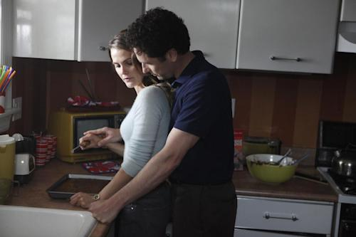 "This undated publicity photo released by FX shows Keri Russell as Elizabeth Jennings, left, and Matthew Rhys as Phillip Jennings in a scene from ""The Americans."" The new FX drama, airing Wednesday at 10 p.m. EST on FX, focuses on two KGB spies posing as an ordinary American couple shortly after Ronald Reagan was elected president. (AP Photo/FX, Craig Blankenhorn)"