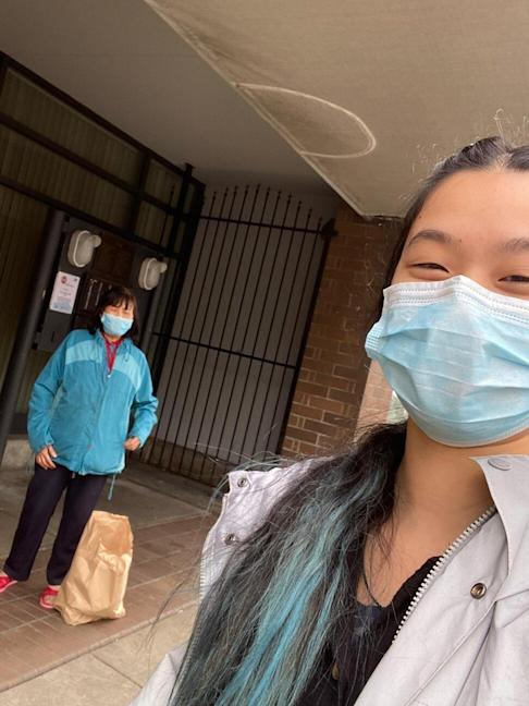 A volunteer (right) for the Chinatown Care Packages project takes a selfie with a recipient in Vancouver on Tuesday, March 31, 2020. Photo: Chinatown Care Packages