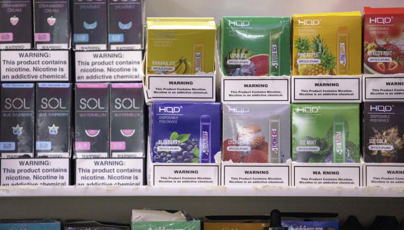 This Jan. 31, 2020 photo shows various brands and flavors of disposable vape devices at a store in the Brooklyn borough of New York. On Thursday, Feb. 6, 2020, the U.S. government began enforcing restrictions on flavored electronic cigarettesaimed at curbing underage vaping. But parents, researchers and students warn that some young people have already moved on to a newer kind of vape that isn't covered by the flavor ban - disposables. (AP Photo/Marshall Ritzel)