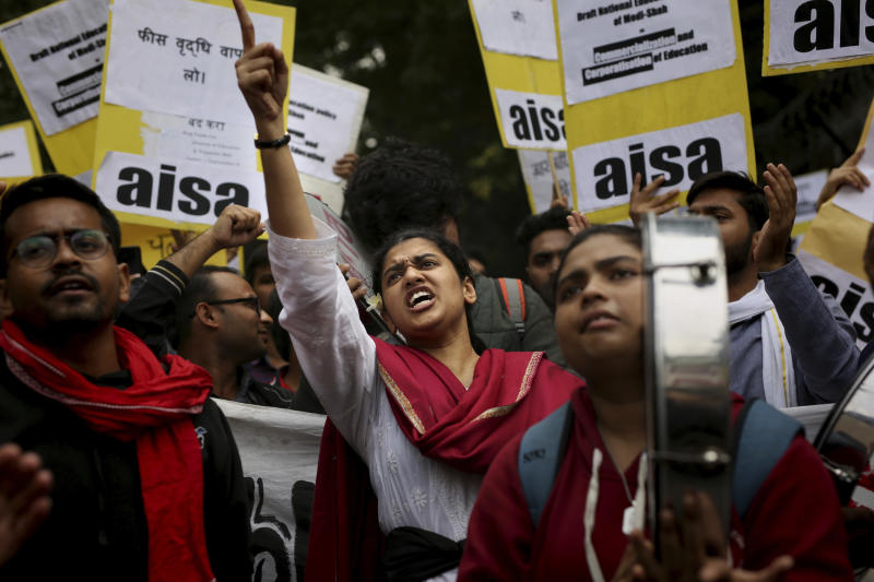 Indian students shout slogans during a protest march towards the Parliament in New Delhi, India, Saturday, Nov. 23, 2019. Hundreds of students of the Jawaharlal Nehru University (JNU) were joined by students from other universities, activists and members of civil society as they marched towards India's parliament to protest against the hostel fee hike, along with their other demands. (AP Photo/Altaf Qadri)