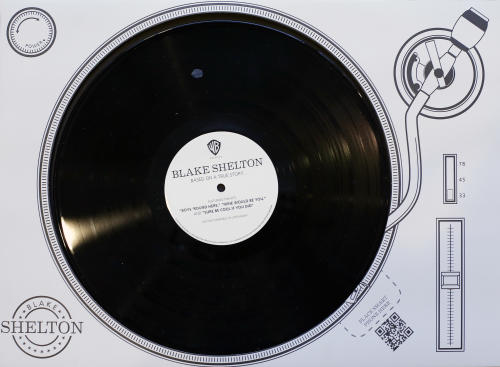 This Oct. 30, 2013 photo shows a virtual record player promoting Blake Shelton that was produced to influence voters of the CMA Awards in Nashville, Tenn. The CMA encourages artists and their labels to educate voters, allowing three email blasts and one mailed product a year. (AP Photo/Mark Humphrey)