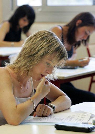 Students take a baccalaureate exam in 2006. One in two Romanian high school pupils failed their university exemption exams this year, a record low level after new anti-fraud measures cut back on cheating, new figures showed