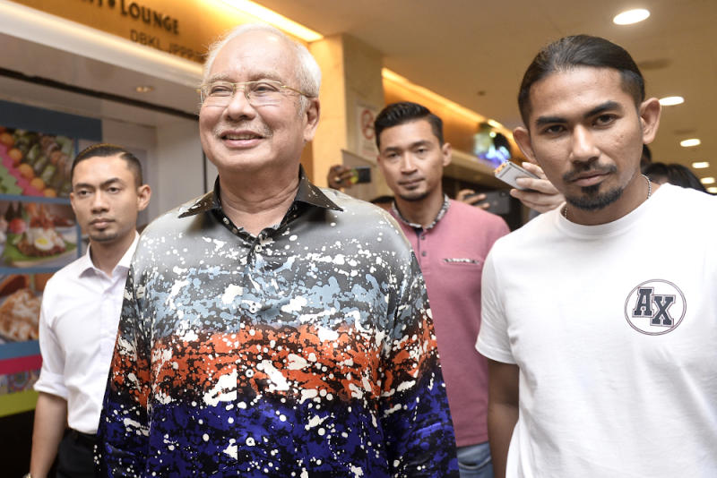 Former prime minister Datuk Seri Najib Razak is seen leaving PWTC after the Umno-PAS meeting February 24, 2020. — Picture by Miera Zulyana
