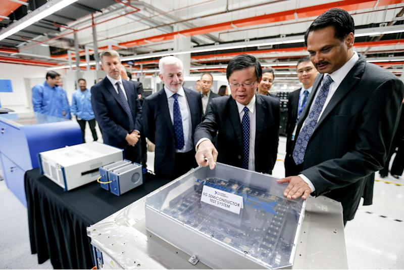 Penang Chief Minister Chow Kon Yeow (second right) during a site visit following the official site opening of the company's new expanded unit in Batu Maung November 21, 2019. — Picture by Sayuti Zainudin