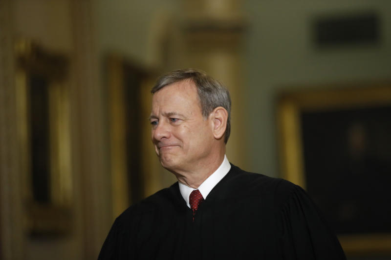 """FILE - In this Jan. 16, 2020, file photo Chief Justice of the United States, John Roberts walks to the Senate chamber at the Capitol in Washington. Roberts told graduating seniors at his son's high school that the coronavirus has """"pierced our illusion of certainty and control"""" and counseled them to make their way in a world turned upside down with humility, compassion and courage. (AP Photo/Matt Rourke, File)"""