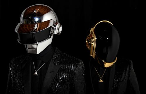 "FILE - In this April 17, 2013 file photo, Thomas Bangalter, left, and Guy-Manuel de Homem-Christo, from the music group, Daft Punk, pose for a portrait in Los Angeles. Daft Punk has set another record on Spotify. The music service said Monday, May 27, 2013, that the electronic duo's new album, ""Random Access Memories,"" had biggest number of streams in its first week in the United States. Spotify wouldn't release the number of streams, but Daft Punk beat the 8 million streams Mumford & Sons set with ""Babel"" last year. (Photo by Matt Sayles/Invision/AP, File)"