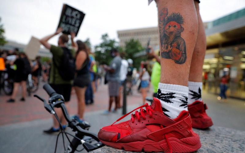 """A man with a Black Lives Matter tattoo at a march in Boston in the US. UK Parliamentary staff have been urged to """"pledge their support"""" for BAME colleagues following the death of George Floyd in May in the US - Brian Snyder/Reuters"""