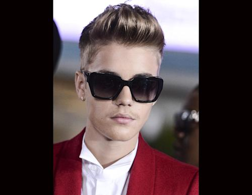 "FILE - Singer Justin Bieber arrives at the premiere of the feature film ""Justin Bieber's Believe"" at Regal Cinemas L.A. Live on in this Dec. 18, 2013 file photo taken in Los Angeles. Bieber has been arrested Thursday Jan 23, 2014 and is accused of DUI and drag racing according to the Miami Beach Police Department. (Photo by Dan Steinberg/Invision/AP, FILE)"