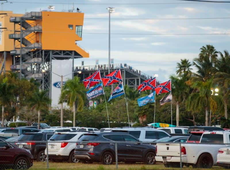 NASCAR drivers drop helmet designer for flag comments