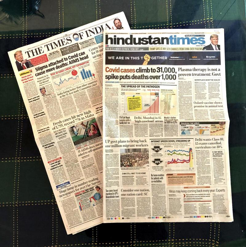 Media massa India perangi virus di front keuangan dan politik