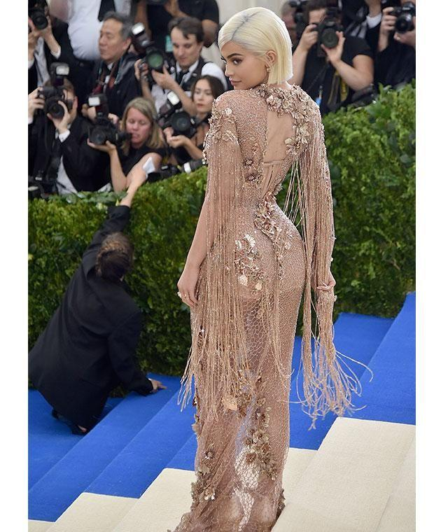 Kylie stood out from the fashion pack in this nude sequinned number. Photo: Getty