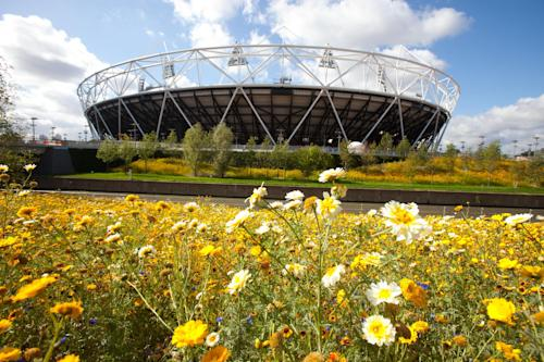 FILE This is a image released on Sept. 30, 2011 by the London 2012 Olympic Delivery Authority shows the parklands area in the south of the Olympic Park looking towards the Olympic Stadium in London. London's Olympic Park will partly reopen to the public this year for a series of summer rock concerts it was reported Tuesday Jan. 22, 2013. The London Legacy Development Corporation the east London park will host the Hard Rock Calling and Wireless festivals in July under a deal with events promoter Live Nation Entertainment. Live Nation also will hold other concerts in park's Olympic Stadium over the summer after gaining exclusive rights to the venue. (AP Photo/Anthony Charlton, ODA, Ho, FILE) EDITORIAL USE ONLY