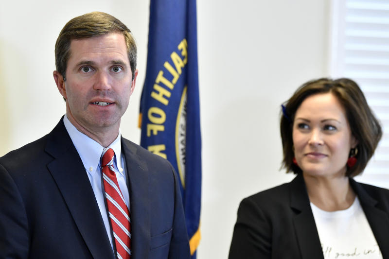 """FILE - In this Nov. 14, 2019, file photo, Kentucky Gov.-elect Andy Beshear, left, and Lt. Gov.-elect Jacqueline Coleman speak with reporters following the concession of incumbent Gov. Matt Bevin in Frankfort, Ky. It's a role that seems scripted for Coleman, as an educator transitioning to the job as a """"full partner"""" in a Democratic administration that vows to make public education a top priority. (AP Photo/Timothy D. Easley, File)"""