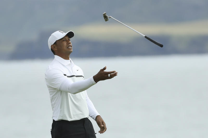 Tiger Woods of the United States throws his club in the air con the 5th green during the second round of the British Open Golf Championships at Royal Portrush in Northern Ireland, Friday, July 19, 2019.(AP Photo/Peter Morrison)
