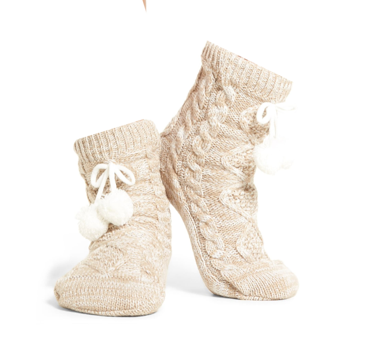 """<p><strong>Ugg</strong></p><p>nordstrom.com</p><p><strong>$49.50</strong></p><p><a href=""""https://go.redirectingat.com?id=74968X1596630&url=https%3A%2F%2Fshop.nordstrom.com%2Fs%2Fugg-pom-pom-fleece-lined-socks%2F4409562&sref=https%3A%2F%2Fwww.cosmopolitan.com%2Fstyle-beauty%2Ffashion%2Fg30926725%2Fwarm-socks-for-women%2F"""" target=""""_blank"""">Shop Now</a></p><p>If you're worried about sweating, grab this moisture-wicking, fleece-lined pair.</p>"""