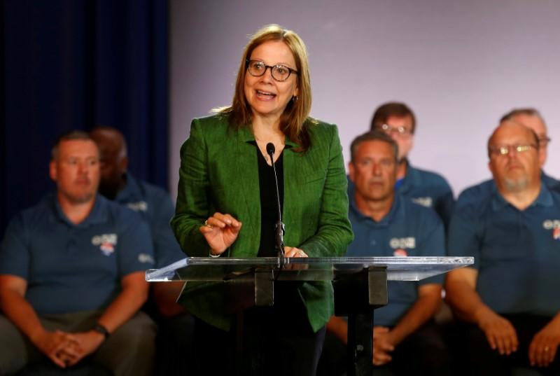 FILE PHOTO: General Motors Chairman and CEO Mary Barra makes a statement as members of the United Auto Workers bargaining committee listen at the start of contract talks between the union and automaker in Detroit