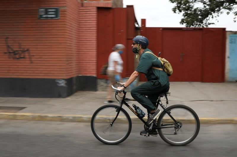 Veterinarian Pedro Villegas leaves his clinic on his bicycle in Caracas
