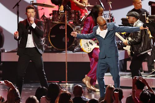 "Robin Thicke, left, and T.I. perform ""Blurred Lines"" at the Grammy Nominations Concert Live! on Friday, Dec. 6, 2013, at the Nokia Theatre L.A. Live in Los Angeles. (Photo by Matt Sayles/Invision/AP)"