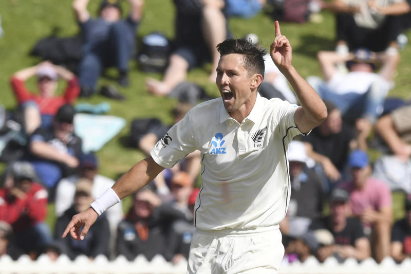 New Zealand's Trent Boult celebrates bowling India's Cheteshwar Pujara for 11 during the first cricket test between India and New Zealand at the Basin Reserve in Wellington, New Zealand, Sunday, Feb. 23, 2020. (AP Photo/Ross Setford)