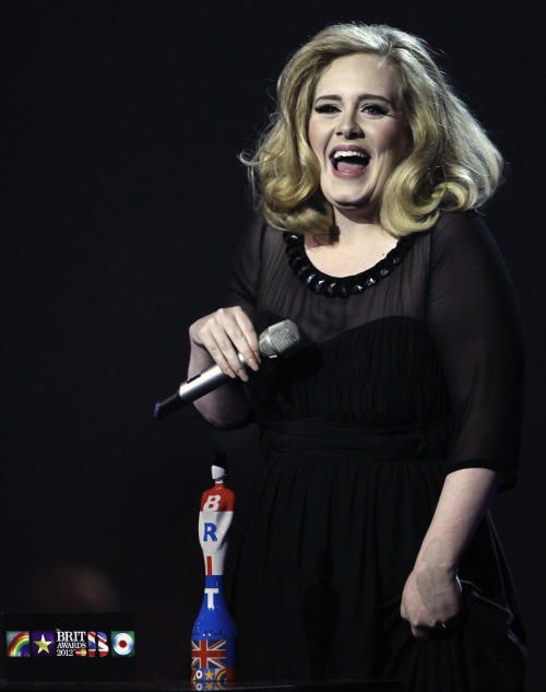 FILE - In this Feb. 21, 2012 file photo, Adele reacts after winning the award for best British Female Solo Artist during the Brit Awards 2012 at the O2 Arena in London. Though Adele didn't have a new album or a worldwide tour in 2012, she's still rolling. After a year of Grammy glory and James Bond soundtracking, Adele has been voted The Associated Press Entertainer of the Year. (AP Photo/Joel Ryan, File)