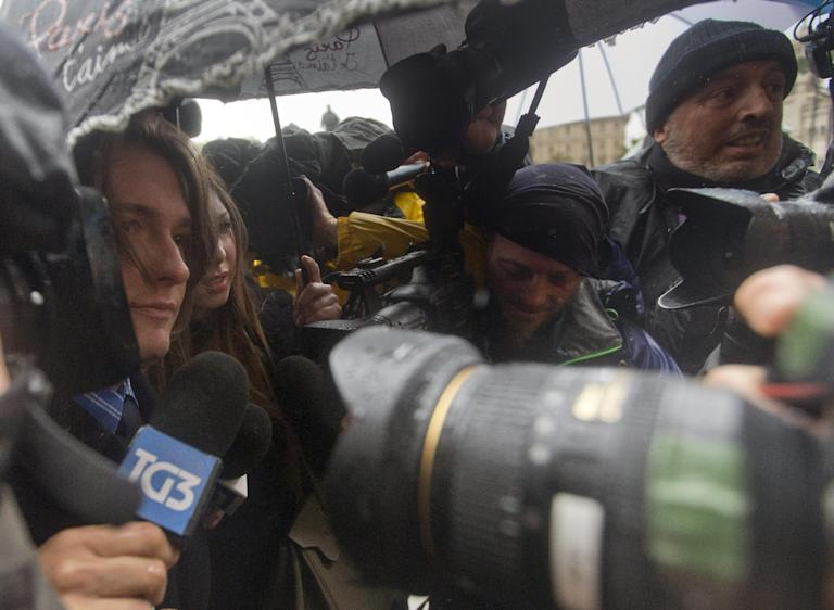 Amanda Knox's Italian ex-boyfriend Raffaele Sollecito, left, is chased by media as he arrives at Italy's highest court building, in Rome, Wednesday, March 25, 2015. American Amanda Knox and her Italian ex-boyfriend expect to learn their fate Wednesday when Italy's highest court hears their appeal of their guilty verdicts in the brutal 2007 murder of Knox's British roommate. Several outcomes are possible, including confirmation of the verdicts, a new appeals round, or even a ruling that amounts to an acquittal in the sensational case that has captivated audiences on both sides of the Atlantic. (AP Photo/Alessandra Tarantino)