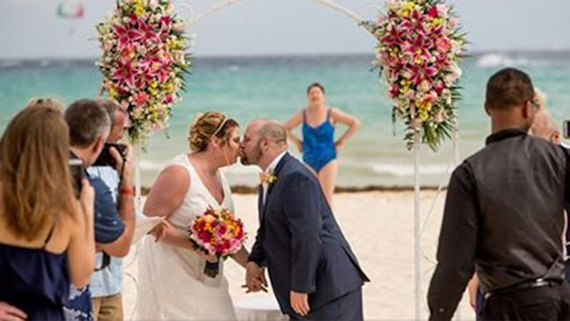 A couple's wedding shots have been marred by an unexpected guest. Photo: Reddit