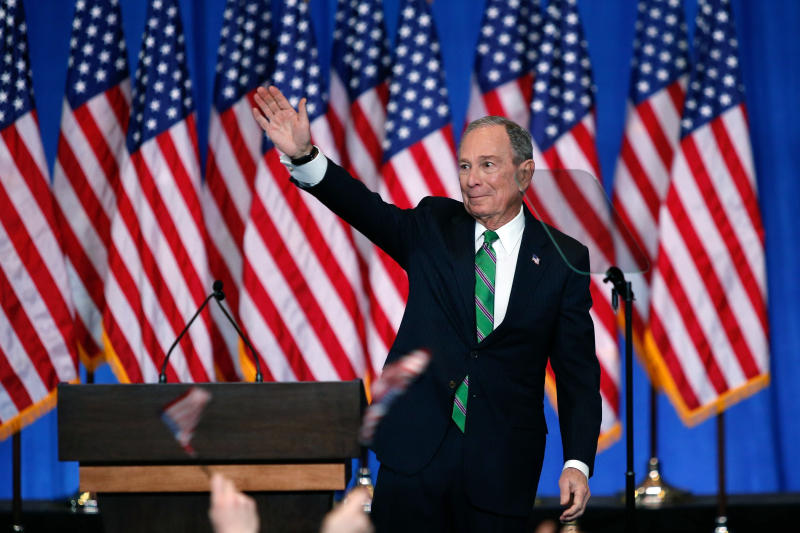 Former Democratic presidential candidate Mike Bloomberg waves to supporters as he announces the suspension of his campaign and his endorsement of former Vice President Joe Biden for president in New York Wednesday , March 4, 2020. (AP Photo/Eduardo Munoz Alvarez)