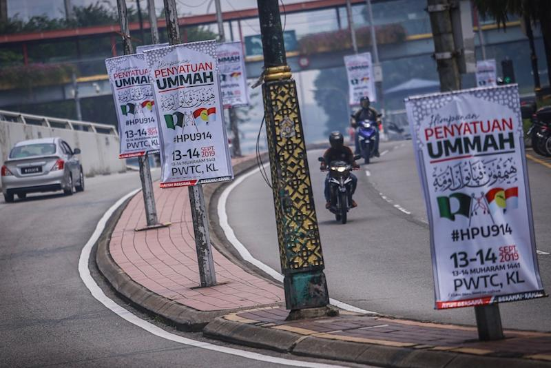 Banners for the Muslim Unity Rally line the road leading to Putra World Trade Centre in Kuala Lumpur September 12, 2019. — Picture by Hari Anggara