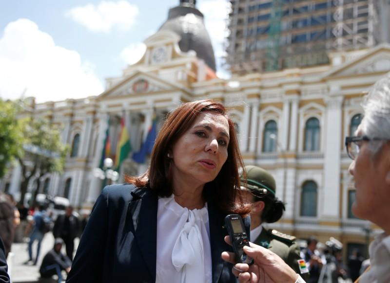 Bolivia's Foreign Minister Karen Longaric speaks to journalists outside of the presidential palace in La Paz