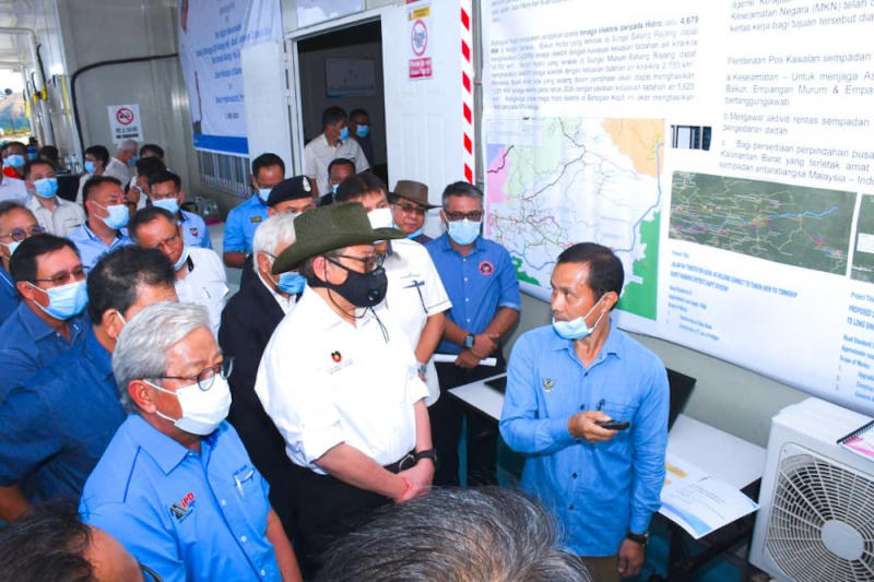 Sarawak Chief Minister Datuk Patinggi Abang Johari Openg (wearing dark face mask) is briefed on the construction progress of the Baleh dam during a site visit on July 7, 2020. — Picture courtesy of the Chief Minister's Office