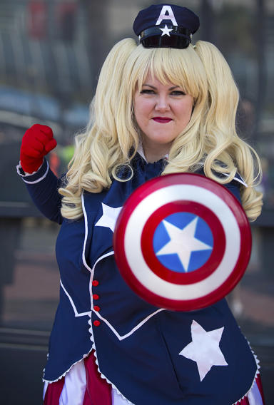 "A cosplayer poses in her costume inspired by comic book character ""Captain America"" during the San Diego Comic-Con International"