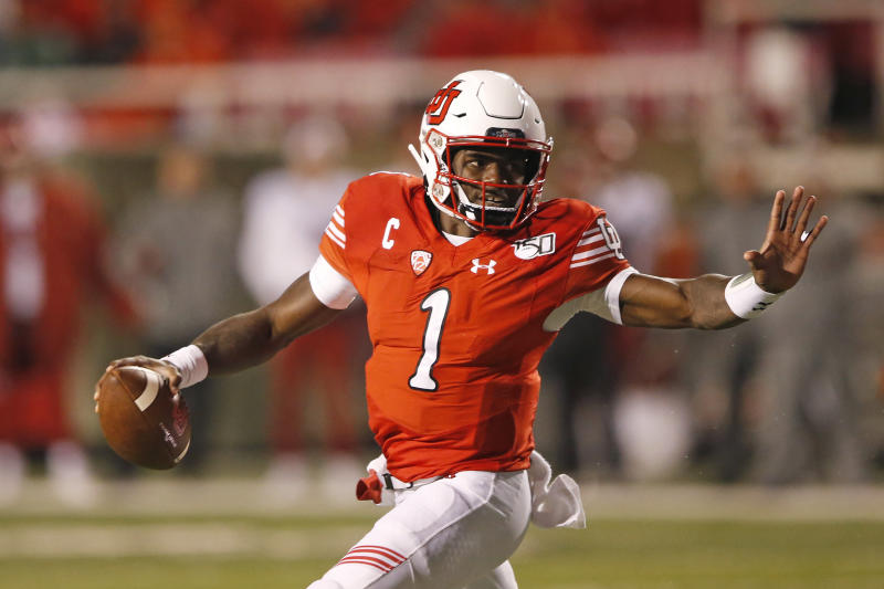 Utah quarterback Tyler Huntley (1) carries the ball in the second half of an NCAA college football game against Washington State Saturday, Sept. 28, 2019, in Salt Lake City. (AP Photo/Rick Bowmer)