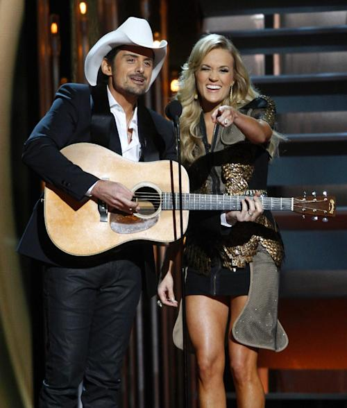 Co-hosts Brad Paisley, left, and Carrie Underwood perform at the 47th annual CMA Awards at Bridgestone Arena on Wednesday, Nov. 6, 2013, in Nashville, Tenn. (Photo by Wade Payne/Invision/AP)