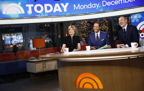 "This image released by NBC shows, from left, guest hosts, Jane Pauley, and Bryant Gumbel with host Matt Lauer on NBC News' ""Today"" show, Monday, Dec. 30, 2013 in New York. Gumbel and Pauley, who worked together on ""Today"" from 1982 to 1989, joined Matt Lauer to co-host on Monday, filling in for Savannah Guthrie and Natalie Morales who were off. (AP Photo/NBC, Peter Kramer)"