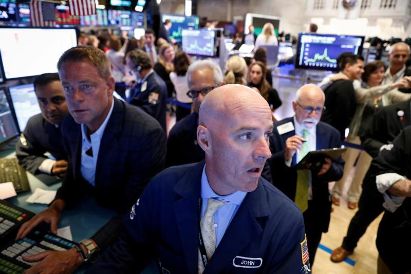 Traders work on the floor at the New York Stock Exchange (NYSE) in New York, U.S., July 31, 2019. REUTERS/Brendan McDermid