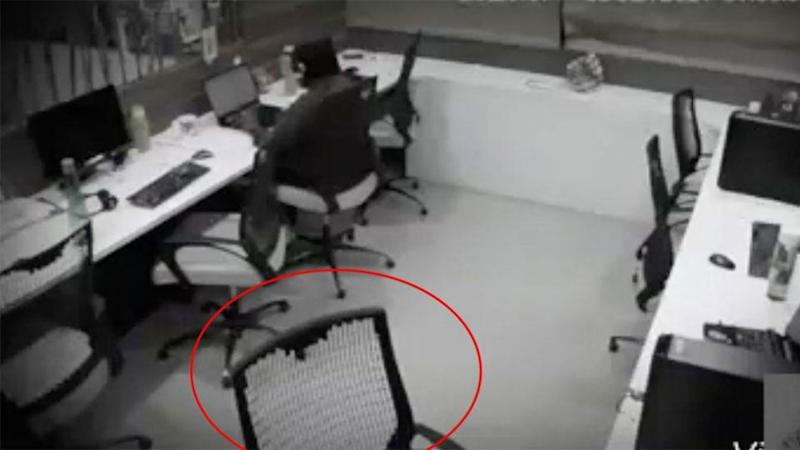 The worker has her headphones in but she notices something strange is happening. Photo: Facebook