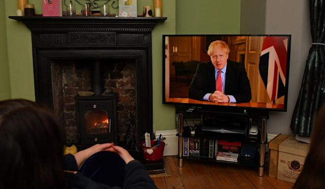 Prime Minister Boris Johnson addresses Britain from 10 Downing Street on Monday, ordering new lockdown measures to slow the coronavirus outbreak. Photo: AFP