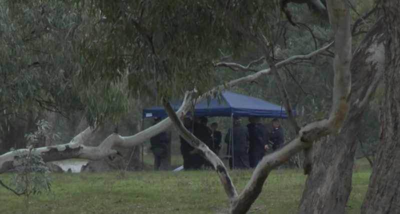Police gather under a shelter on the rainy night at Barnawartha North after the shooting. Source: Nine News