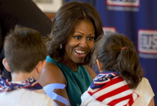 First lady Michelle Obama visits with children at the USO Warrior and Family Center in Fort Belvoir, Va., Wednesday, Sept. 11, 2013, during a service project to commemorate the Sept. 11th National Day of Service and Remembrance at Food and Friends. (AP Photo/Jacquelyn Martin)