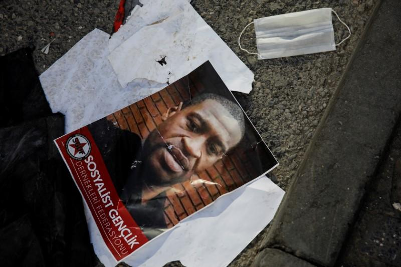 A portrait of George Floyd lies on the ground after a scuffle during a protest in Istanbul
